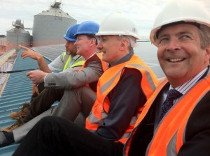 From left, Will Cottrell, of Brighton Energy Co-op, with Climate Change Minister Greg Barker, Hove MP Mike Weatherley and Shoreham Port chief executive Rod Lunn on the roof of Shed 10 at Shoreham Harbour