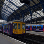 A First Capital Connect train in Brighton Station. By Vera Blossom from Flickr