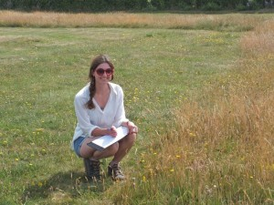 Researcher Katie Fensome by the long grass