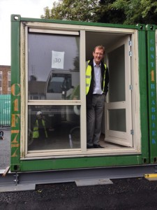 Andy Winter inspects one of the original Brighton shipping containers
