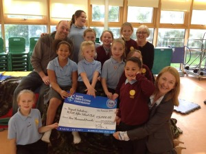 Whitehawk After School Project children and play worker Gary Allan with Caroline Ridley, CEO of Impact Initiatives, receive funding from Sussex police and crime commissioner Katy Bourne