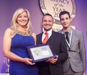 David Vaughan and Mike Everett collect the prize for Best Small Estate Agency of the Year from businesswoman Michelle Mone