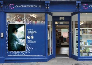 Cancer Research UK contactless giving shop window