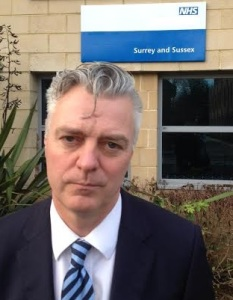Simon Kirby outside NHS England Surrey and Sussex offices