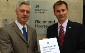 Simon Kirby presenting a petition to Health Secretary Jeremy Hunt