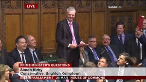 Hove MP Mike Weatherley looks on as Simon Kirby, the MP for Brighton Kemptown, speaks at Prime Minister's Questions