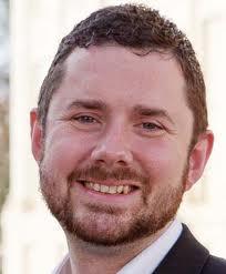 Councillor Phélim Mac Cafferty