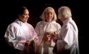 Kate Lawson during her ordination as a priest with Tanya Hockley and Beverley Miles at All Saints Church in Hove