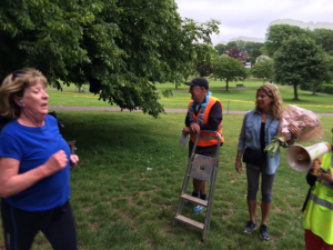 Thanks a bunch: Sally Gunnell, with flowers, watches runners complete the 5k around Hove Park
