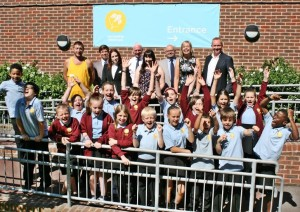 City Academy Whitehawk pupils celebrate being rated good by Ofsted with parent Dave Bailey, chair of governors Stephen Dawson, parent Nicola-Jayne Coonan, head David Williams, parent Tiffany Lawrence, council leader Warren Morgan, City College assistant principal Rebecca Conroy and Fonthill Foundation chairman Andrew Goodall