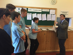 Patcham High School pupils in the weighing room at Brighton Racecourse with the Clerk of the Scales Leigh O'Brien