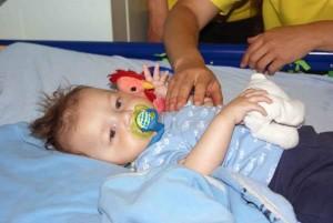 Blake Mlotshwa receives reiki therapy at the Royal Alexandra Children's Hospital in Brighton