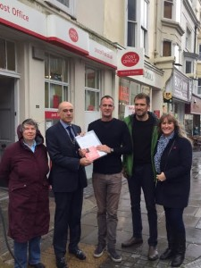 Brunswick resident and post office campaigner Sheila Levenson, Post Office crown area manager for the south east John Taylor, Hove MP Peter Kyle, Councillor Ollie Sykes and City Books owner Inge Sweetman at the handover of the petition to save the Brunswick Town Post Office