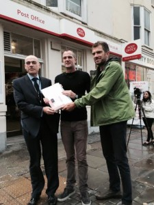 John Taylor poses with the petition to save the Brunswick Town Crown Post Office in Western Road, Hove, with Peter Kyle MP and ward councillor Ollie Sykes