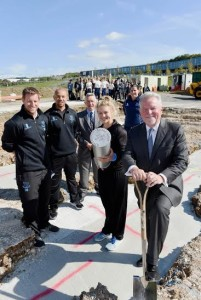 A time capsule is buried at the new cricket centre which is being built in the grounds of the Brighton Aldridge Community Academy by, from left, Sussex cricketers James Anyon and Tymal Mills, cricketer Tara Norris, Sussex CCC chairman Jim May, Sussex Women's coach Charlotte Burton and Sir Rod Aldridge - Picture by Simon Dack / Vervate www.vervate.com