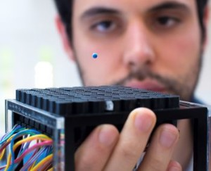 PhD student Asier Marzo uses a tractor beam to levitate a polystyrene ball with soundwaves