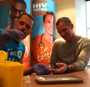 Tom Boyt checks Peter Kyle as the Hove MP encourages people to have an HIV test as part of an awareness campaign