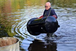 A volunteer retrieves the bins last weekend