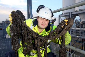 A Southern worker with rag retrieved from the sewers. Picture by Ciaran McCrickard of Connors