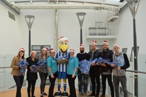 Brighton and Hove Albion players Kim Stenning, Charlotte Gurr, Faye Baker, Bruno Saltor, David Stockdale, Gordon Greer and Jamie Murphy visited young patients at the Royal Alex