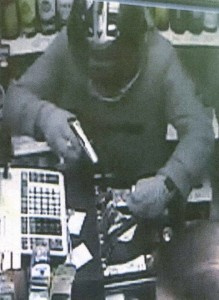 Armed robber caught on camera in a convenience store in Portland Road, Hove