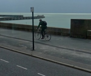 A cyclist riding on the pavement near Brighton Marina by John Keogh on Flckr