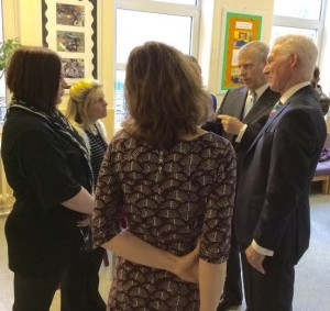 Prince Andrew speaks with City Academy Whitehawk parents Cassandra Scaife, left, and Kelly Pattinson as head teacher David Williams listens