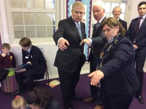 Children from Roedean help pupils at the City Academy Whitehawk in the school's reading zone as Prince Andrew speaks with City Academy head David Williams and Sharon Maguire from Roedean