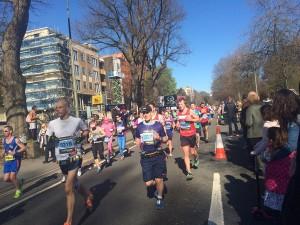 Brighton Marathon Runners make their way along Preston Road. Picture by Becky Snowden.
