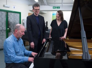 Martin Butler, Ed Hughes and Laura McDermott with Sussex University's new Steinway piano