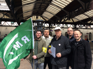 Train guards on strike outside Brighton Station in April