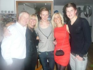 Connor Saunders, right, with his family