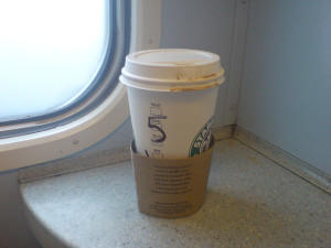 takeaway coffee on a train by Nico Hogg on Flickr
