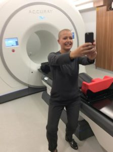 Sara Cutting takes a selfie with one of the new tomotherapy machines