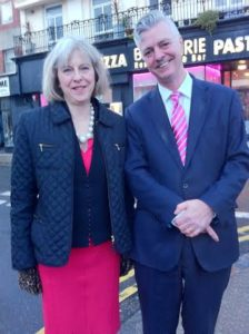 Theresa May and Simon Kirby in St James's Street, Brighton, after visiting the AIDS Memorial in New Steine