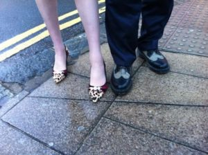 Best foot forward - Theresa May and Simon Kirby in Kemp Town - one wearing leopard print kitten heels and the other in his trademark Doc Martens