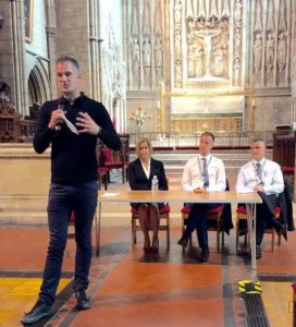 Peter Kyle chairs a public meeting at All Saints Church in Hove where Southern executives faced angry passengers