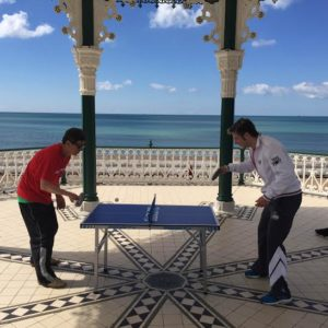 Brighton Table Tennis Club coach Wen Wei Xu beats the world champion Andrew Baggaley on the Bandstand in Brighton