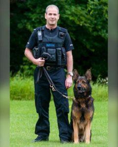 Sergeant Gareth Jackson with Sparky