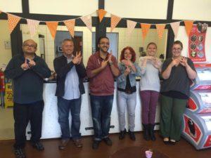 Inside Dottie's deaf café with, from left, Roger Griffiths, James Moffatt, Jonathan Hajebi, Karen Edwards, Steph Hajebi and Holly Ferrie