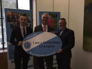 Simon Kirby backs campaign for more heart defibrillators with Jake Morrison, chief executive of the Oliver King Foundation, and founder Mark King