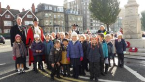 Dudley Button, from the Royal British Legion, with the Mayor Pete West and children from St Andrew's CE Primary School marking the Armistice