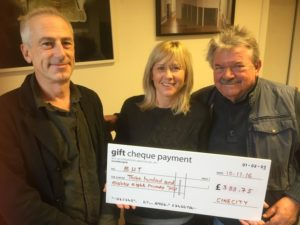 Tim Brown, from Cinecity, hands over a cheque to Jo Berry and Bill Randall from BHT