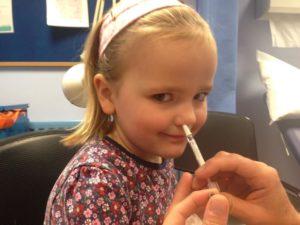 Grace Whitehead, 4, has her nasal spray flu  vaccination