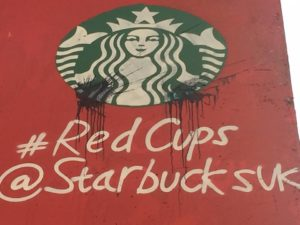 Paint splats over the second Starbucks logo which appeared over the weekend. Photo by Anna Clark