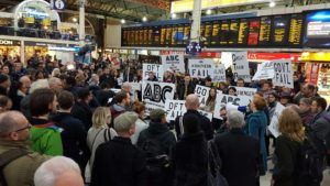 Commuters protest about the dire train service during the long-running industrial dispute