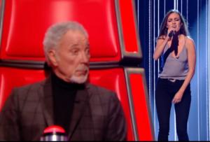 Tom Jones listens as Clara Hurtado sings on The Voice on ITV