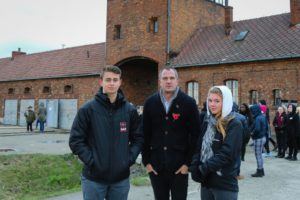 Peter Kyle with Cardinal Newman students Joe McDermott and Matty Whyte at Auschwitz