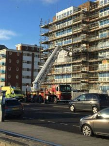 Firefighters helped paramedics bring a patient down to a waiting ambulance on Hove seafront