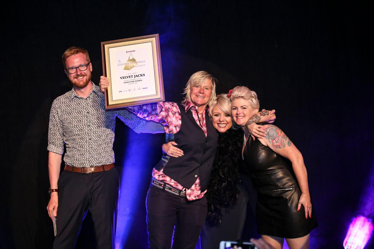 Lloyd Rus Moyle Presents An Award To Velvet Jacks The Golden Handbag